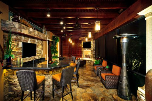 custom bar setup on luxury patio design at new Ayers custom home