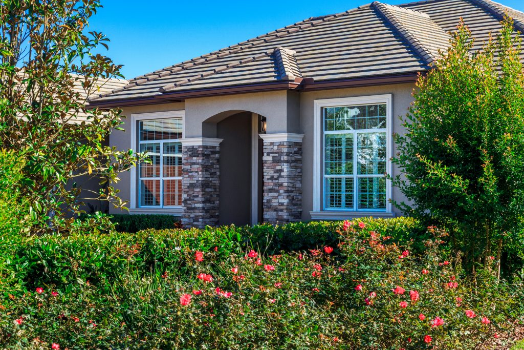 exterior shot with landscaping of finished custom home built in Orlando