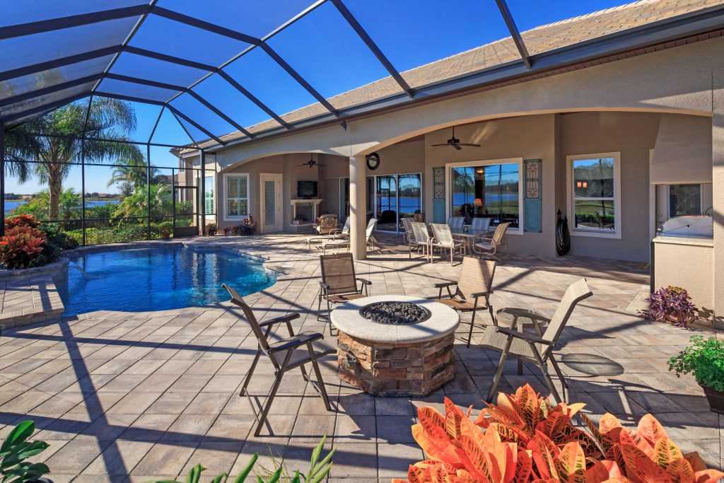beautiful custom patio and pool at new residential home by Ayers