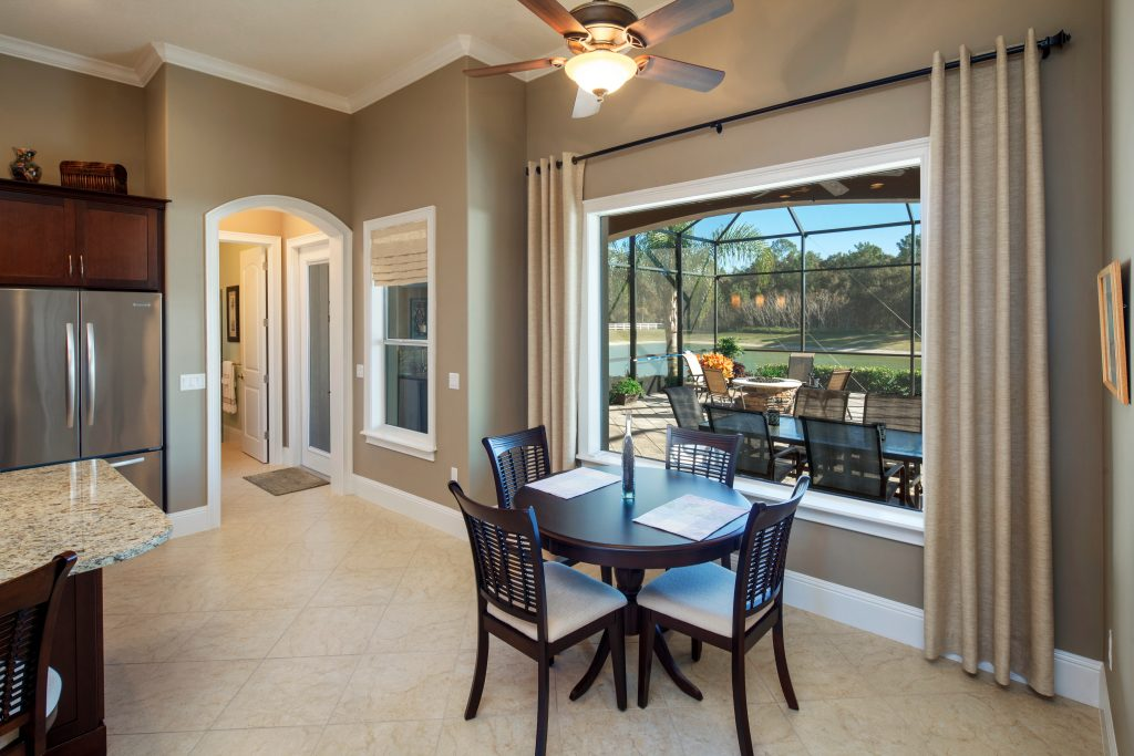 custom dining room with view of pool patio by Ayers, a Florida custom home builder