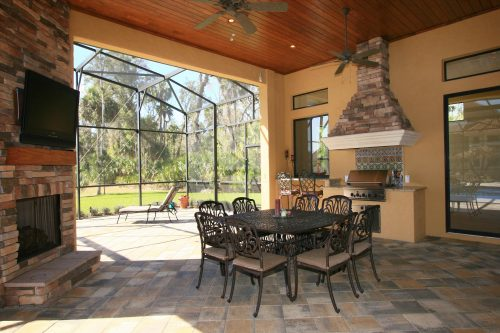 custom summer kitchen on patio designed and built by Ayers, a custom homebuilder in Orlando