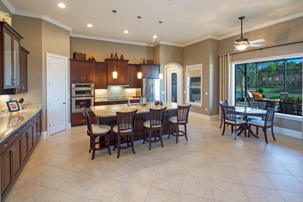 custom kitchen and dining area at new home by Ayers Custom Homes in Orlando