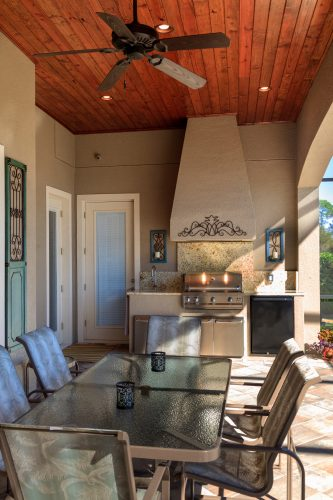 outdoor summer kitchen design by Ayers Custom Homes in Orlando