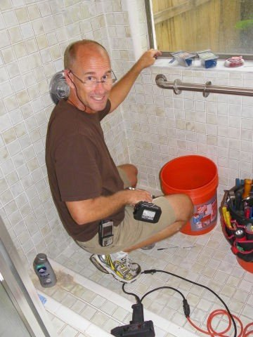 Charles Ayers of Ayers Homes installing a shower grab bar