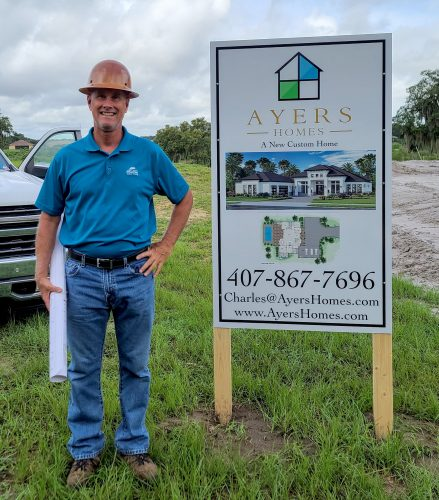 Charles Ayers of Ayers Homes installing a shower grab barv
